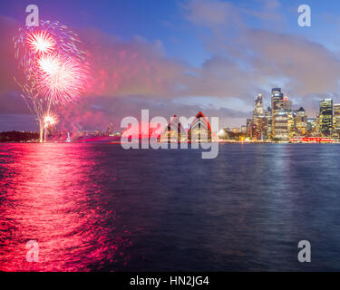 The Sydney Opera House is lit red and with Chinese style fireworks the Chinese new year. Sydney, Australia - Stock Photo