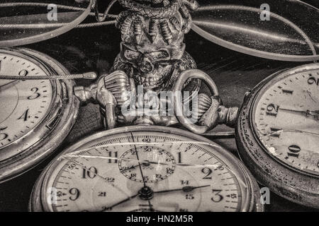Vintage Still Life with old golden pocket watches , glasses and stamp seal in black and white - Stock Photo