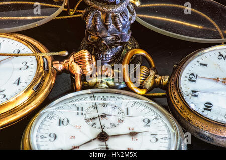 Vintage Still Life with old golden pocket watches , glasses and stamp seal in colour - Stock Photo