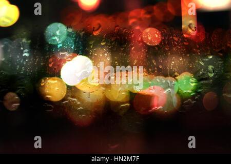 wet window with night bokeh lights - Stock Photo