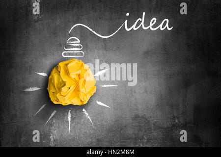 yellow paper light bulb idea - Stock Photo