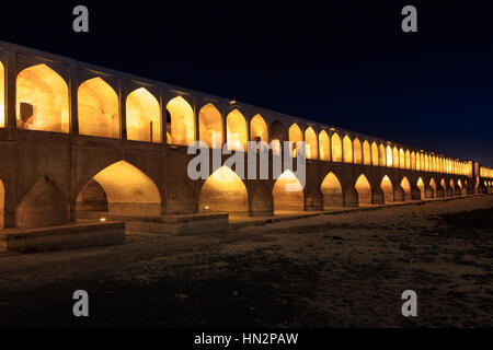 Night view of Si-o-Seh Pol, also called the Bridge of 33 Arches, Isfahan, Iran - Stock Photo