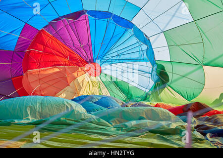 Hot air balloon inflating inside view, backlight - Stock Photo