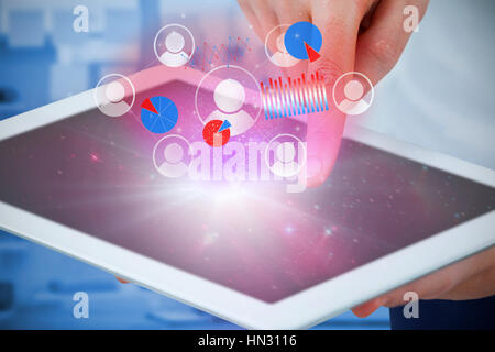 Hands using digital tablet against against view of office interior with sticky note on window - Stock Photo