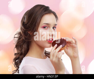 beautiful young model eating dessert, isolated - Stock Photo