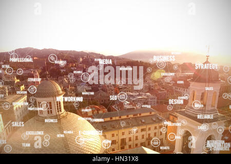 Sphere of icons and words against beautiful view over houses - Stock Photo