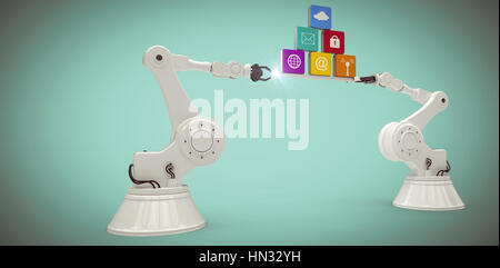 Digitally generated image of metallic robotic hands holding computer icons against green background - Stock Photo