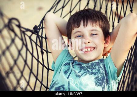 Cute little boy relaxing in a hammock - Stock Photo