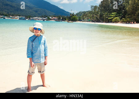 Cute little boy on Malibu beach at Koh Phangan Island, Thailand - Stock Photo