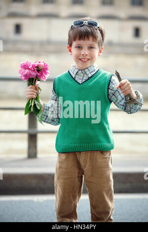 Happy little boy enjoying himself in Paris, France - Stock Photo