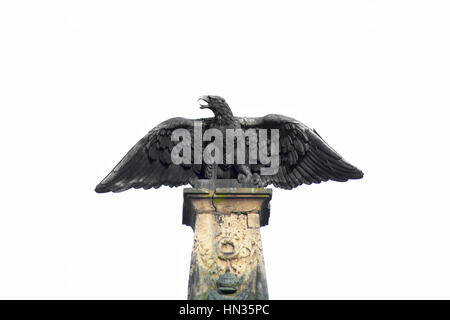 Bronze eagle with wings spread sculpture, found on `Melaten-Friedhof` graveyard in Cologne, germany - Stock Photo