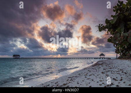 The sun rises over the white sandy beach of Cayo Guillermo in Cuba. - Stock Photo