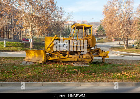 Bor, Serbia,- December 12, 2015: Old yellow bulldozer placed as a monument in the industrial city - Stock Photo