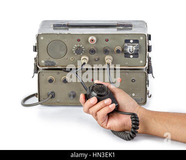 old dark green amateur ham radio holding in hand on white background - Stock Photo
