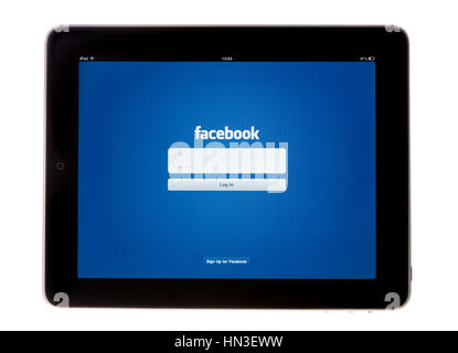 Bath, United Kingdom - November 9, 2011: An Apple iPad showing the log in screen of the Facebook App, shot against - Stock Photo