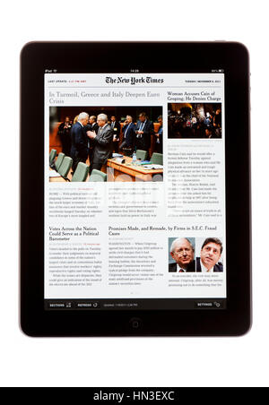 BATH, UK - NOVEMBER 8, 2011: An Apple iPad displaying the iPad edition of The New York Times newspaper against a - Stock Photo