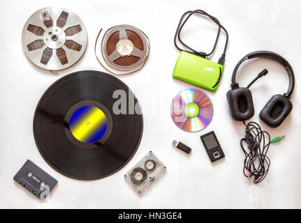 set of retro and modern audio carriers on white background - Stock Photo