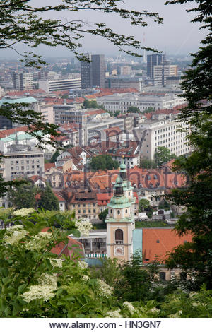 The city as seen from a path to the Ljubljana Castle on a hill above Ljubljana, Slovenia. - Stock Photo