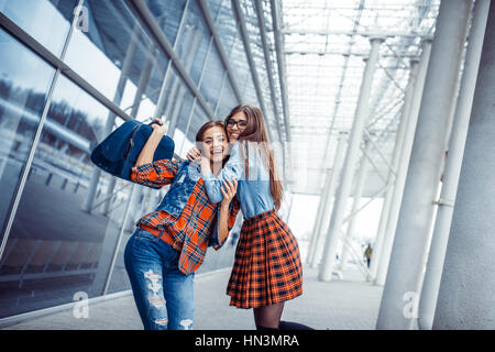 Girls having fun and happy when they met at the airport.Art proc - Stock Photo