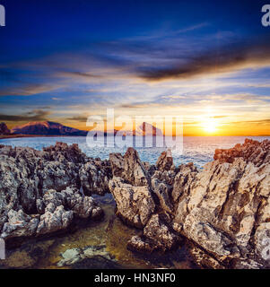Sunset over the rocks. - Stock Photo