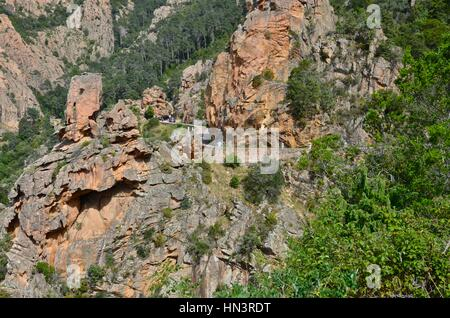 Les Calanches, volcanic rock formations on Corsica. - Stock Photo