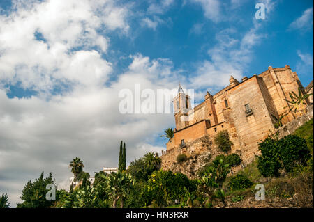 Sight from below of the Parochial Church of the Purest Conception with a blue sky and gray storm clouds. - Stock Photo
