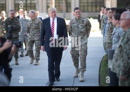 U.S President Donald Trump walks past soldiers escorted by U.S. Army Gen. Joseph Votel during a visit to U.S. Central - Stock Photo