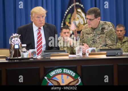 U.S President Donald Trump listens as Gen. Joseph Votel, commander of U.S. Central Command, provides a briefing - Stock Photo