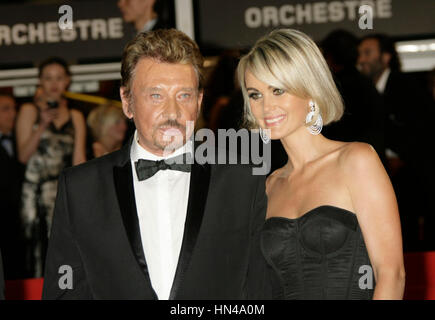 Johnny Hallyday and Laeticia Hallyday at the premiere for the film, 'Vengence' at the 62nd Cannes Film Festival - Stock Photo