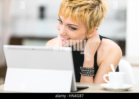 Woman Smiling At Someone In Her Computer Screen, She's Having A ...
