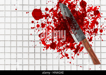 knife with grunge of blood on toilet mosaic floor, halloween bloody murder or death crime killer violation concept. - Stock Photo