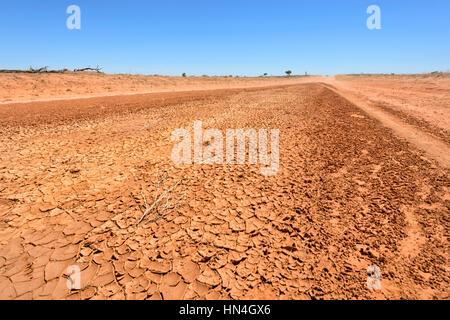 Dried Mud on an Outback dirt road between Pooncarie and Menindee, New South Wales, Australia - Stock Photo