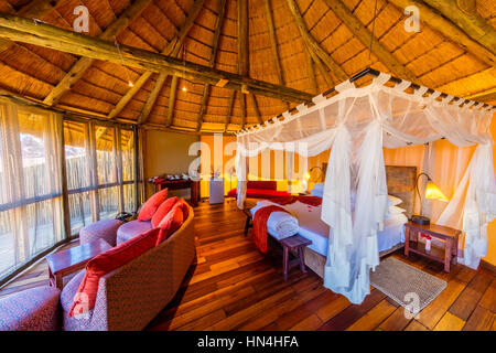 Sossus Dune Lodge is nestled against the low-lying mountains in the Namib-Naukluft National Park, providing guests - Stock Photo