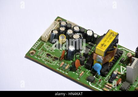 Close-up view of an electronic power supply card of a household appliance. - Stock Photo