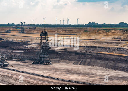 GARZWEILER, GERMANY - SEPTEMBER 01, 2016: Two huge excavators mine brown coal - Stock Photo