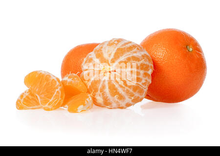 Clementines with a peeled clementine isolated on white background - Stock Photo