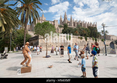 PALMA DE MALLORCA, SPAIN - OCTOBER, 9 : Street performer and passing tourists on the pedestrian area outside the - Stock Photo