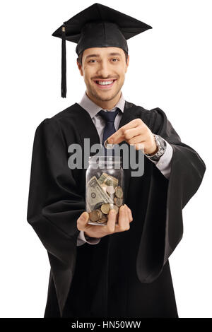 Graduate student putting a coin into a jar isolated on white background - Stock Photo