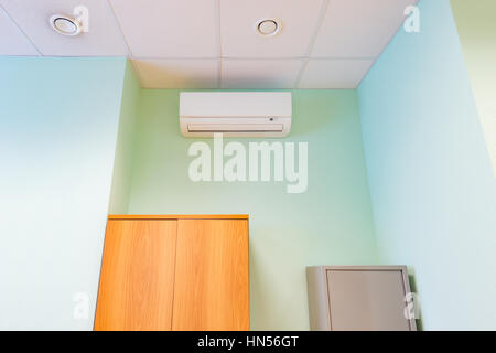 Air conditioner on wall background. - Stock Photo