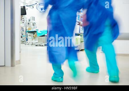 Doctors running in a hurry - Stock Photo
