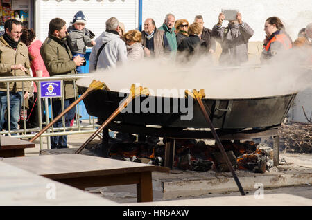 Huge pan with stew cooking on open fire at Fiesta de matanza, Annual Celebrations in Ardales.Andalusia, Spain - Stock Photo