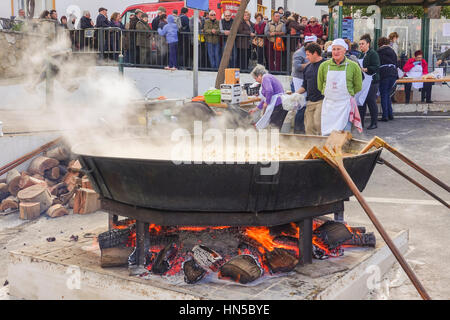 Huge pan with stew cooking on open fire at Fiesta de matanza, Annual Celebrations in Ardales.Andalusia, Spain. - Stock Photo
