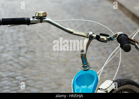 Helm of bicycle which is standing on the street of old city - Stock Photo