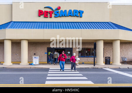 Fairfax, USA - December 3, 2016: Petsmart store facade in Virginia with people crossing street - Stock Photo