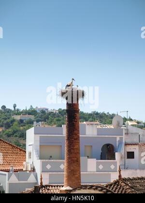 A stork's nest on a chimney, Silves, Portugal - Stock Photo