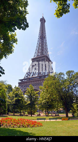 A vertical panoramic view of the Iconic Eiffel Tower and gardens on a hot summer day. - Stock Photo