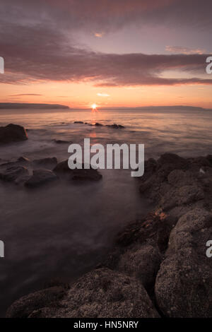 Sunset at the coast overlooking Portstewart Strand in Northern Ireland. - Stock Photo
