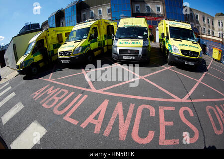 liveried ambulances parked on duty in designated bays at Manchester Royal Infirmary  accident and emergency department - Stock Photo