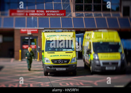 liveried ambulances parked on duty in designated bays at Manchester Royal Infirmary England UK  accident and emergency - Stock Photo