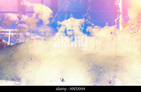Blue ice on glass, background, texture. Freezing snow on glass, transparent glass of window in winter and melting - Stock Photo